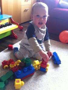 Reuben plays with Baby Duplo.